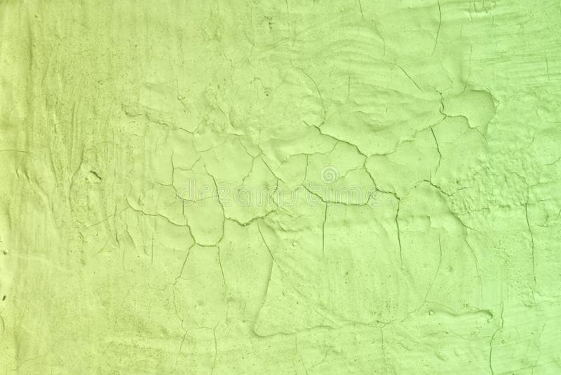 Textura quebrada áspera do estuque do grunge amarelo - fundo abstrato agradável da foto fotografia de stock royalty free