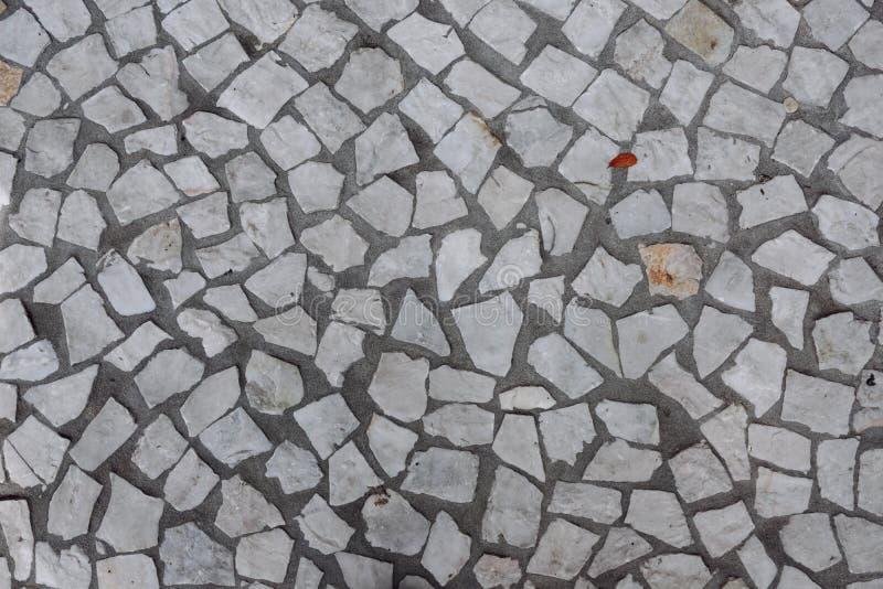 Textura quebrada del suelo de baldosas foto de archivo for Textura baldosa