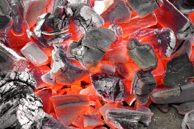 Textura quente de incandescência do fundo do carvão vegetal fotos de stock royalty free