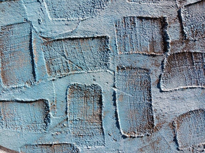 Textura real azul del fondo del yeso con áreas de depresiones rectangulares imagenes de archivo