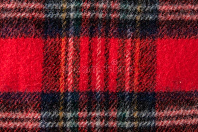 Textura roja del fondo de la tela de la franela de la bufanda imagenes de archivo