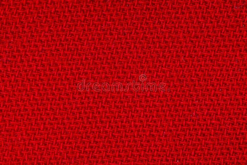 Textura roja del fondo de la tela Detalle del primer del material de materia textil fotos de archivo libres de regalías