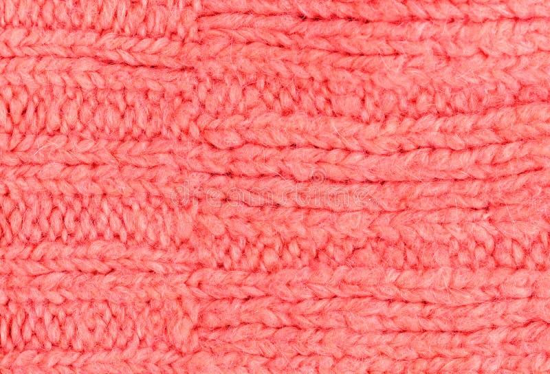 Textura rosada del color de la tela de lana hecha punto para el papel pintado color imagenes de archivo
