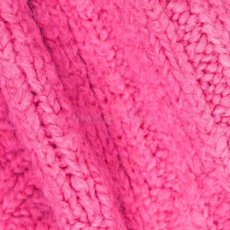 Textura rosada del color de la tela de lana hecha punto para el papel pintado color imagen de archivo