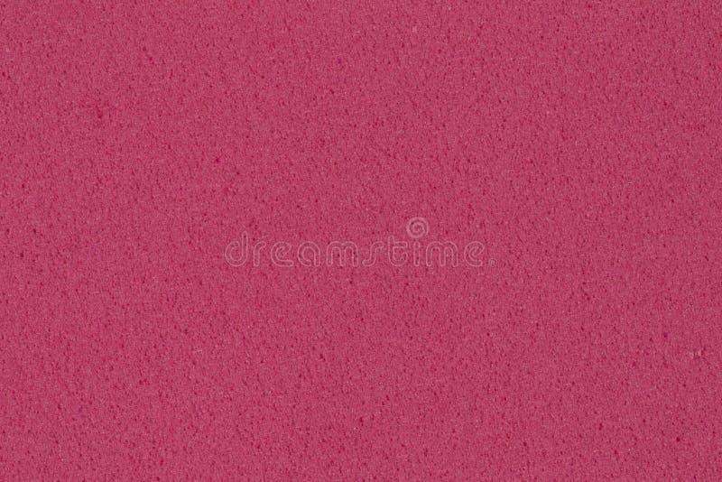 Textura rosada oscura de EVA de la espuma con la superficie granular para su proyecto único imágenes de archivo libres de regalías