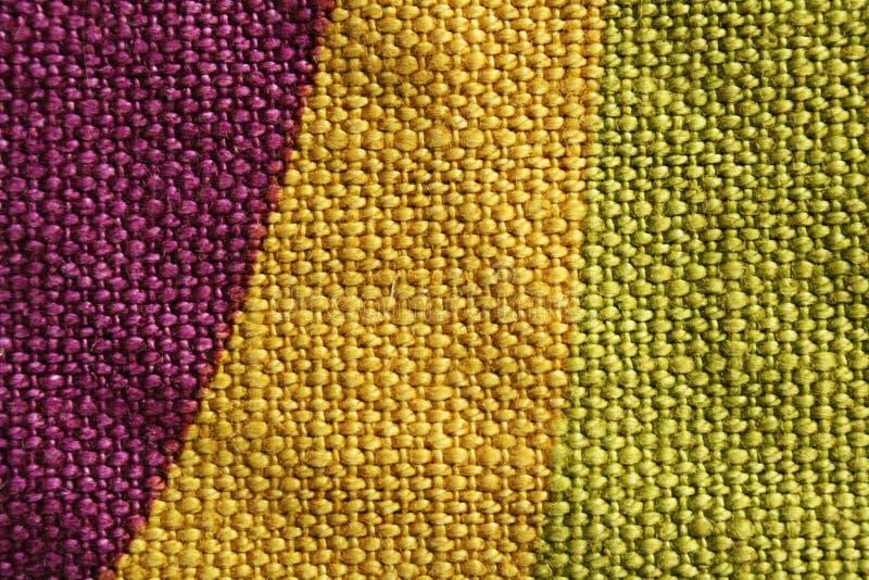 Textura roxa e verde amarela da tela foto de stock