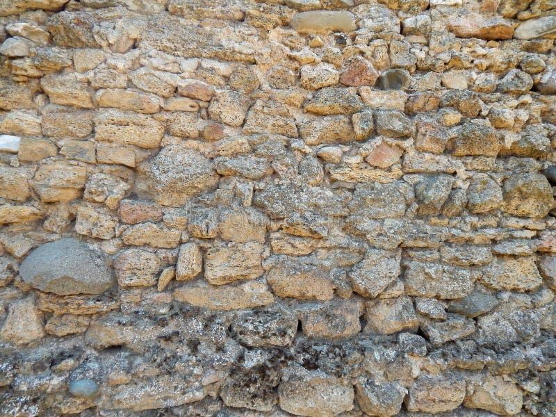 Textura Sandstone O arenito em forma natural cria uma textura e um fundo únicos foto de stock