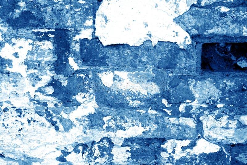 Textura suja velha da parede de tijolo no tom dos azuis marinhos fotografia de stock royalty free