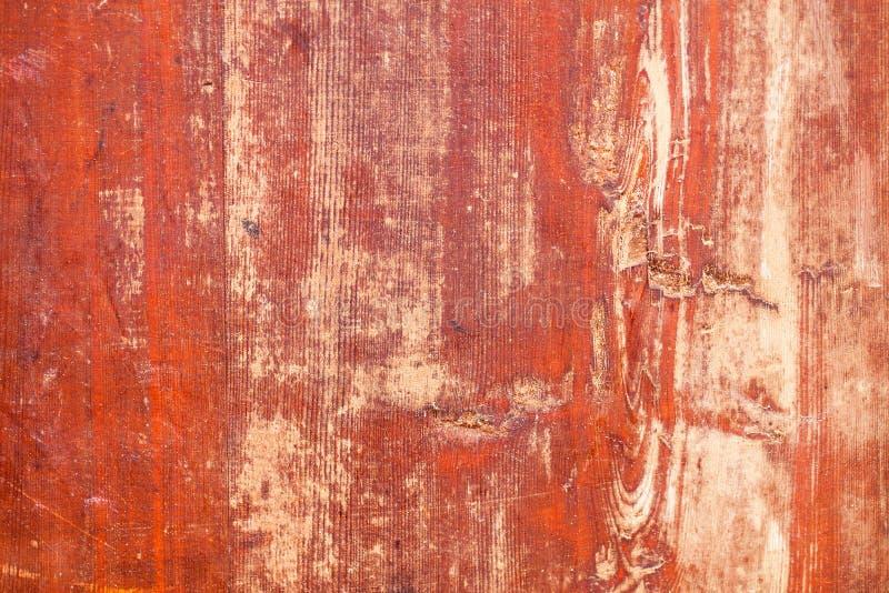 Textura suja vermelha velha da folha da madeira compensada fotografia de stock