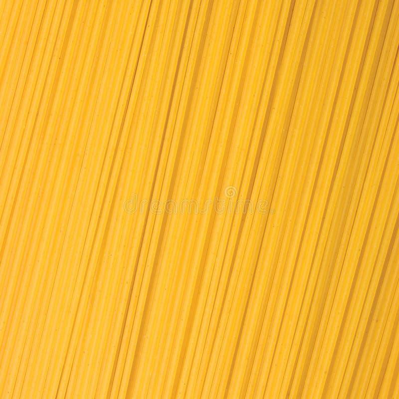 Textura tradicional do fundo do close up da massa dos espaguetes, grande teste padrão macro textured detalhado imagem de stock