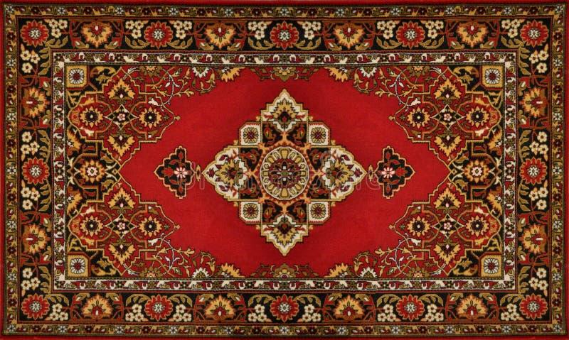 Textura tradicional ornamentado vermelha do tapete imagens de stock