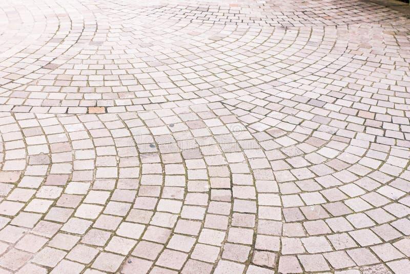 Textura urbana do pavimento de pedra da cauda foto de stock royalty free