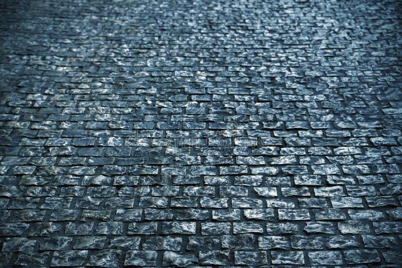 Textura velha do fundo da superfície de estrada da pedra do godo preto e branco fotos de stock royalty free