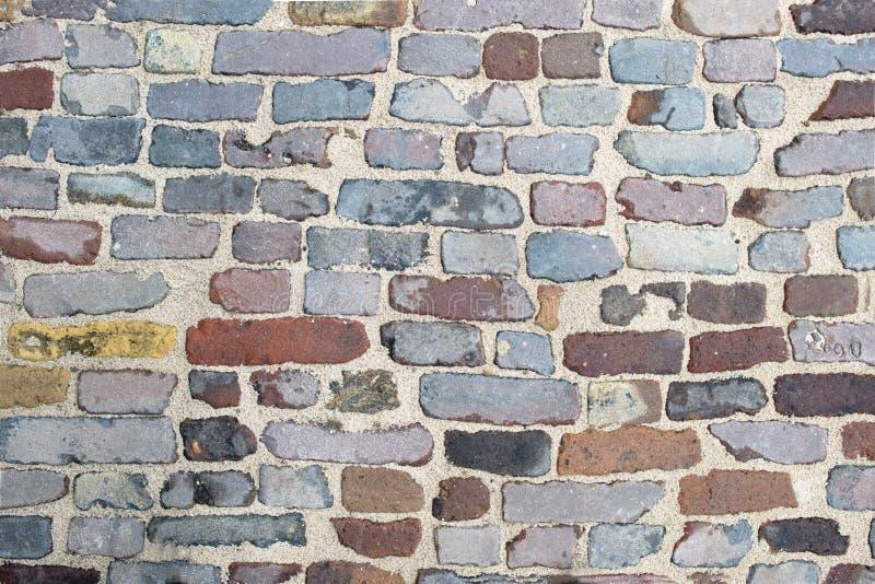 Textura velha do teste padrão da estrada do tijolo imagem de stock