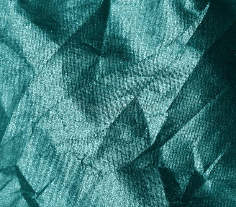 Textura verde arrugada de la tela fotografía de archivo libre de regalías