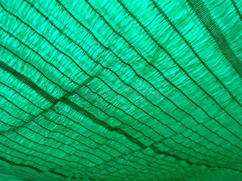 Textura verde da rede da proteção imagem de stock