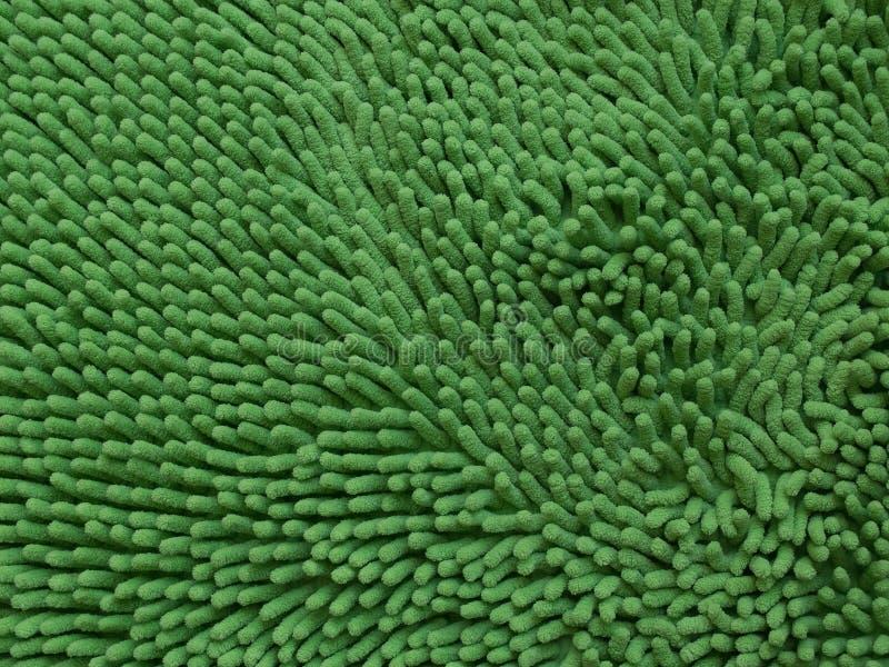 Textura verde do capacho ou do tapete ou do pano da limpeza do close-up imagem de stock