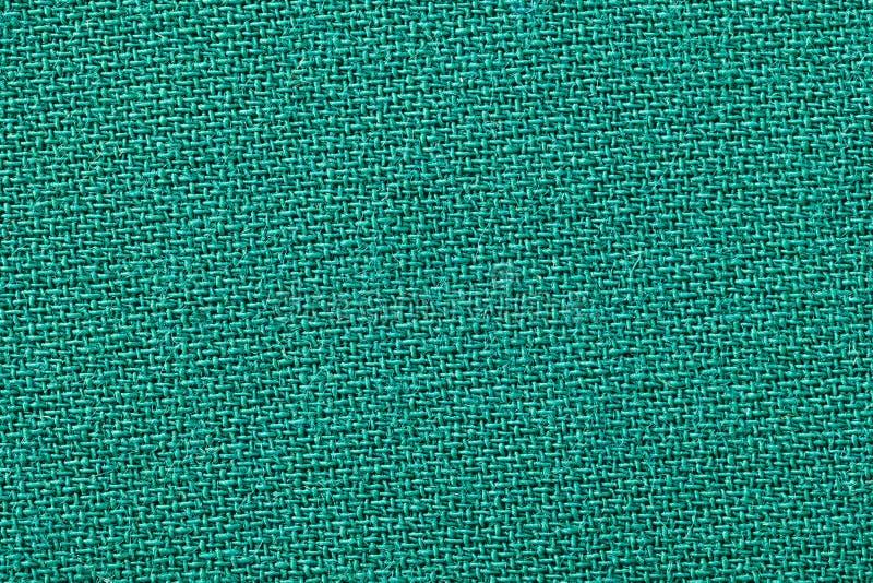 Textura verde do fundo da tela Detalhe de close-up do material de matéria têxtil foto de stock royalty free