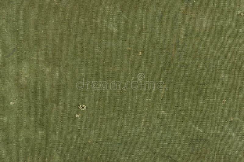 Textura verde-oliva do algodão com os rasgos da American National Standard dos riscos fotografia de stock