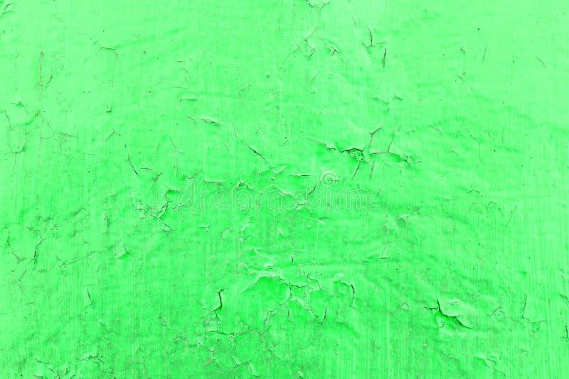 Textura verde tóxica rachada da pintura Close-up da parede vermelha pintada velha Fundo abstrato de Grunge Superfície riscada vin fotos de stock royalty free