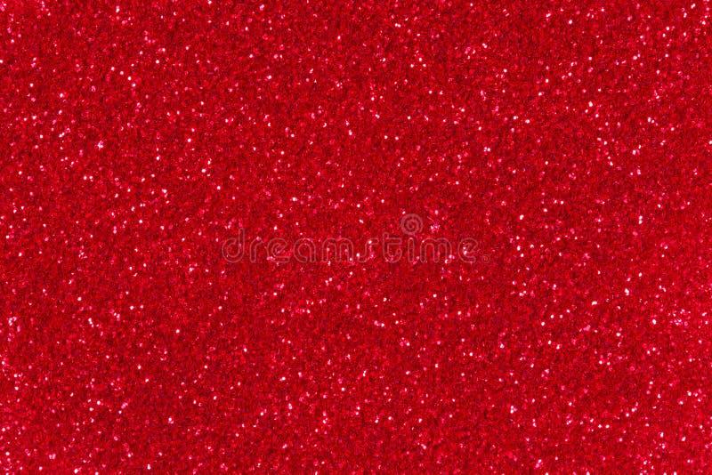 Textura vermelha do Glitter Fundo abstrato da cintilação para o feriado dos anos novos ou do Natal foto de stock
