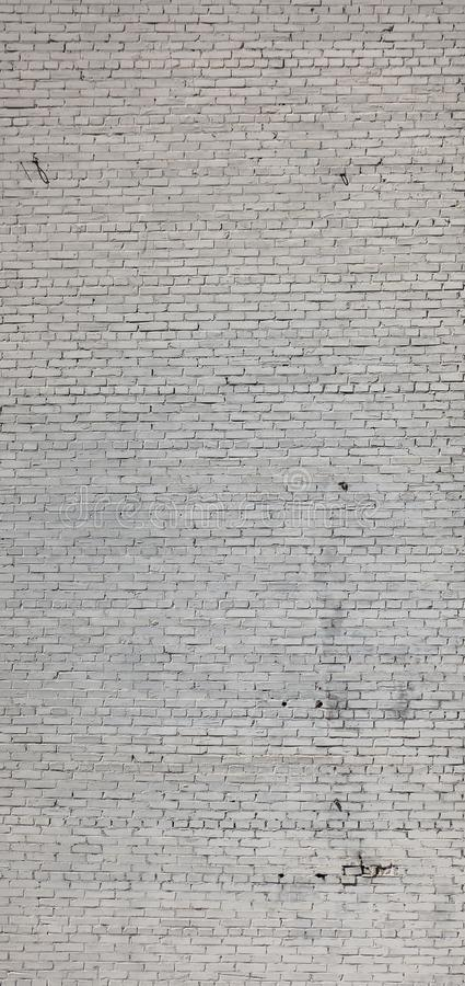A textura vertical de uma luz do tijolo usou a parede fotos de stock
