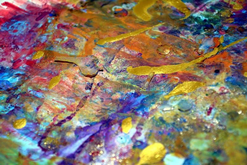 A textura violeta alaranjada dourada da pintura, cores cerosos vívidas, contrasta o fundo criativo fotografia de stock