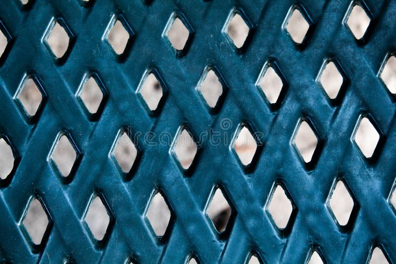 Textural background, blue. There is a diamond shape. royalty free stock image