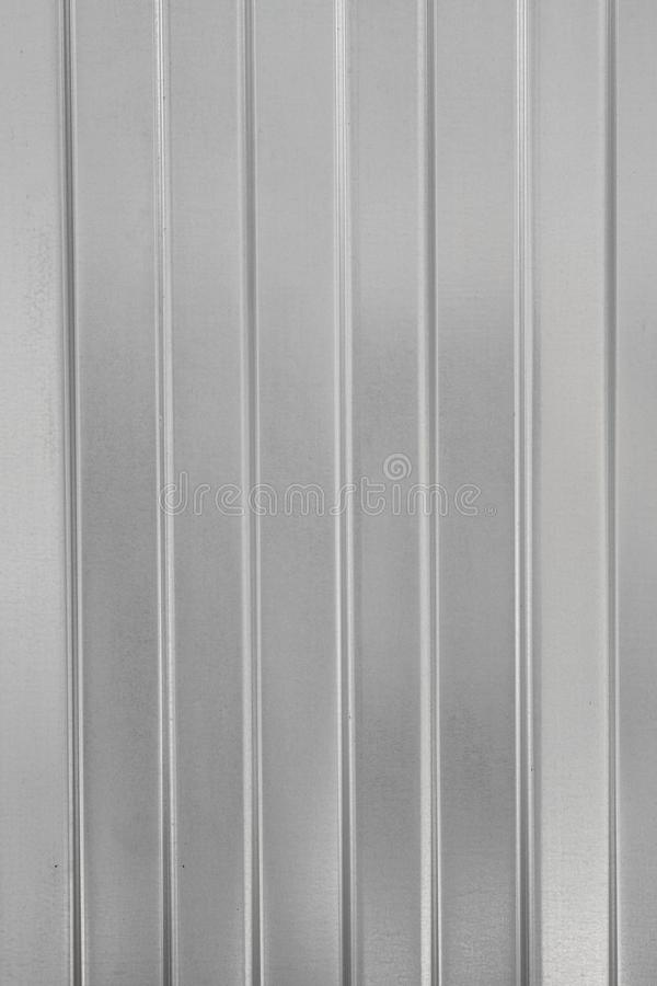 Textural background of gray corrugated metal sheet or profiled panel. Material for light metal constructions, roof or fence stock photos