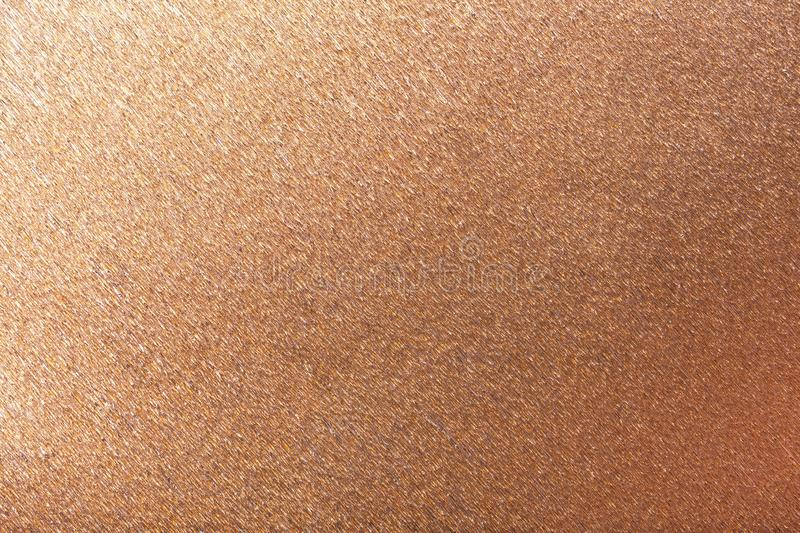 Textural of bronze background of wavy corrugated paper, closeup royalty free stock photography