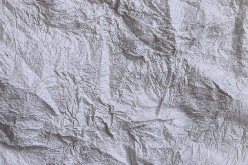 Textural of crumpled tissue paper in white and grey tone. stock images
