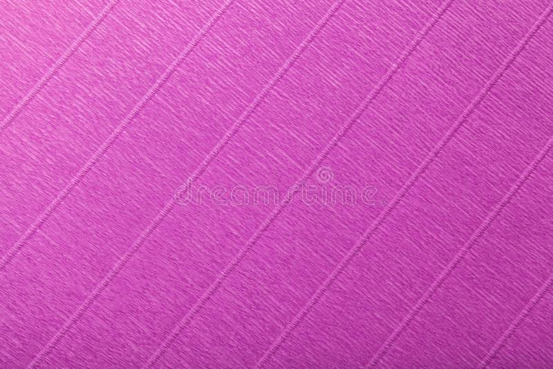 Textural of dark purple background of wavy corrugated paper, closeup stock photography