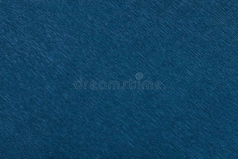 Textural of navy blue background of wavy corrugated paper, closeup stock photos