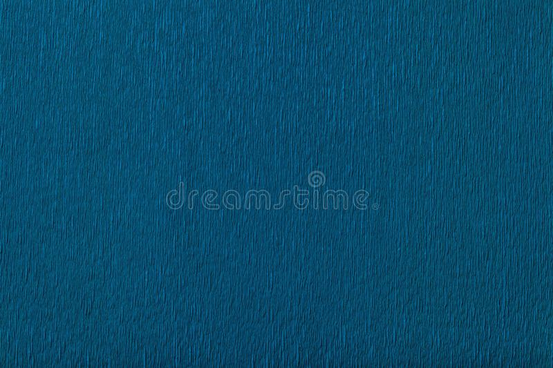 Textural of navy blue background of wavy corrugated paper, closeup royalty free stock images
