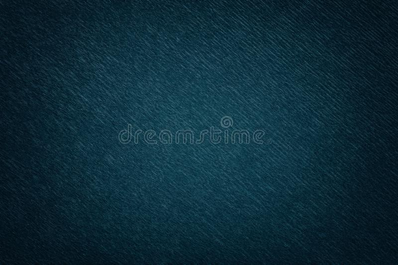 Textural of navy blue background of wavy corrugated paper, closeup royalty free stock photo