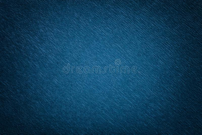 Textural of navy blue background of wavy corrugated paper, closeup stock images