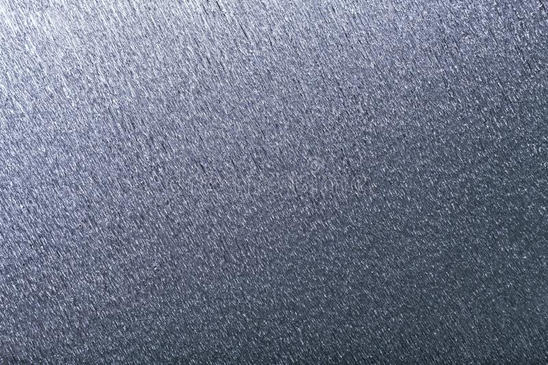 Textural of silver background of wavy corrugated paper, closeup stock photography