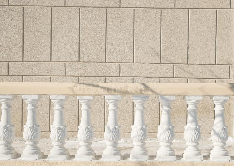 Textural wall of a house on the street with rails of massive handrails stock image