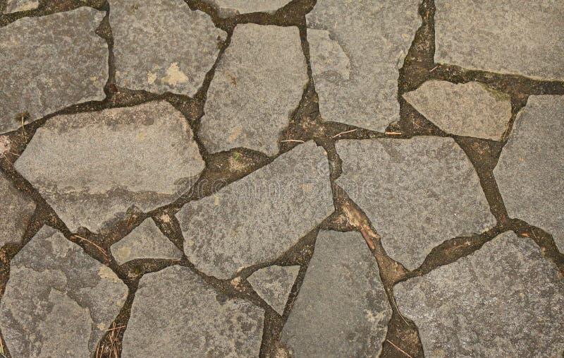 Texturbakgrund av stenen vaggar modellgolvdekoren royaltyfri foto