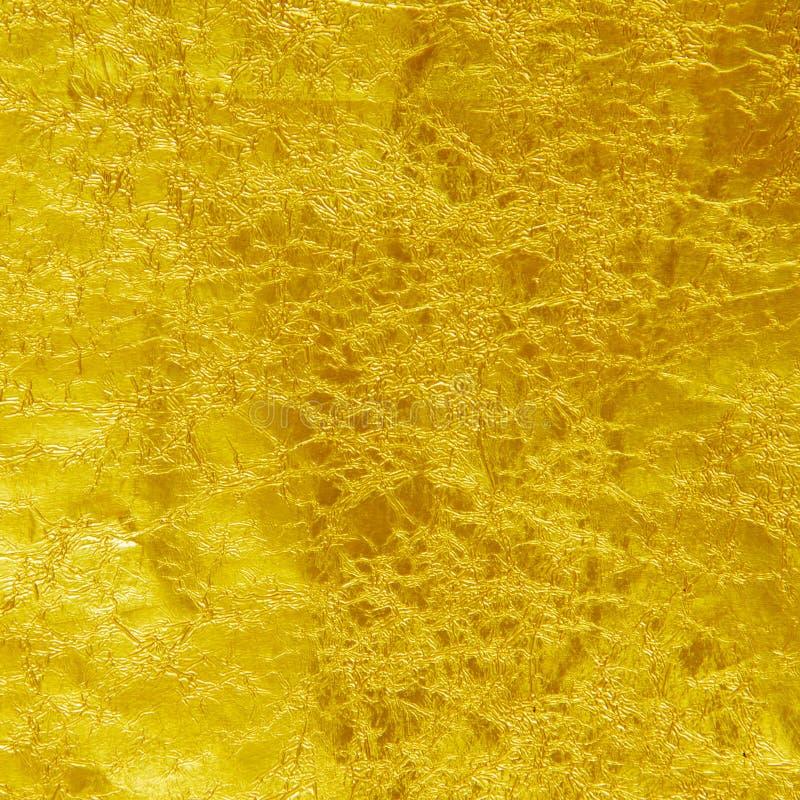 Texturbakgrund för guld- folie arkivfoto