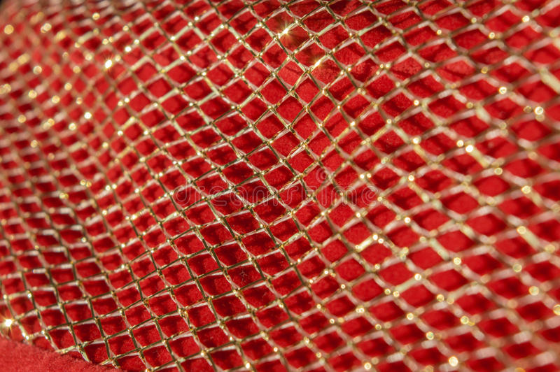 Texture abstraite avec la grille miroitante brillante d'or au soleil Bri photos stock