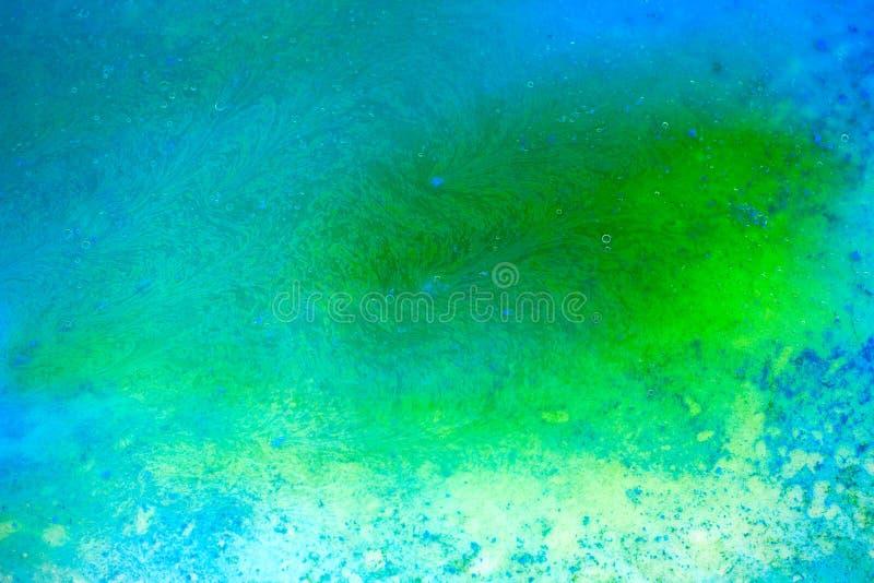 texture abstraite liquide de peinture verte et bleue de mélange image libre de droits
