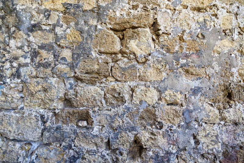 Texture of the ancient castle wall of stone and granite stock images