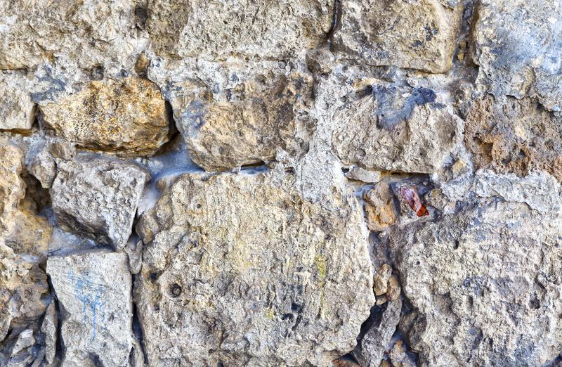 Texture of the ancient castle wall of stone and granite stock photography