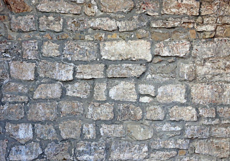 Texture of the ancient gray brick wall stock photography