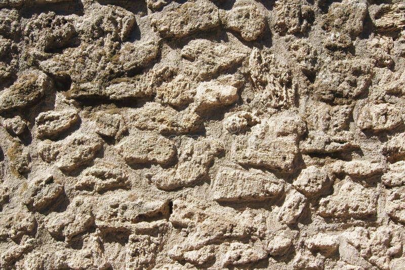 The texture of ancient masonry lava stone royalty free stock photography