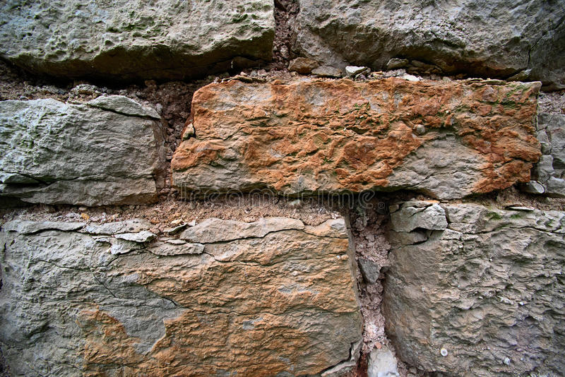 Texture ancient medieval stone collapsing wall royalty free stock photography