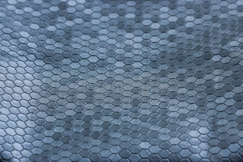 Texture argentée en métal d'une pluralité d'hexagones une couleur grise de beau contexte images libres de droits