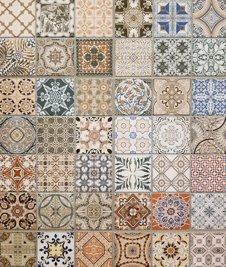 Texture - Array of colorful Mediterranean style square tiles. Texture - Array of colorful Mediterranean style square ceramic tiles with many shades of blue, red royalty free stock photos