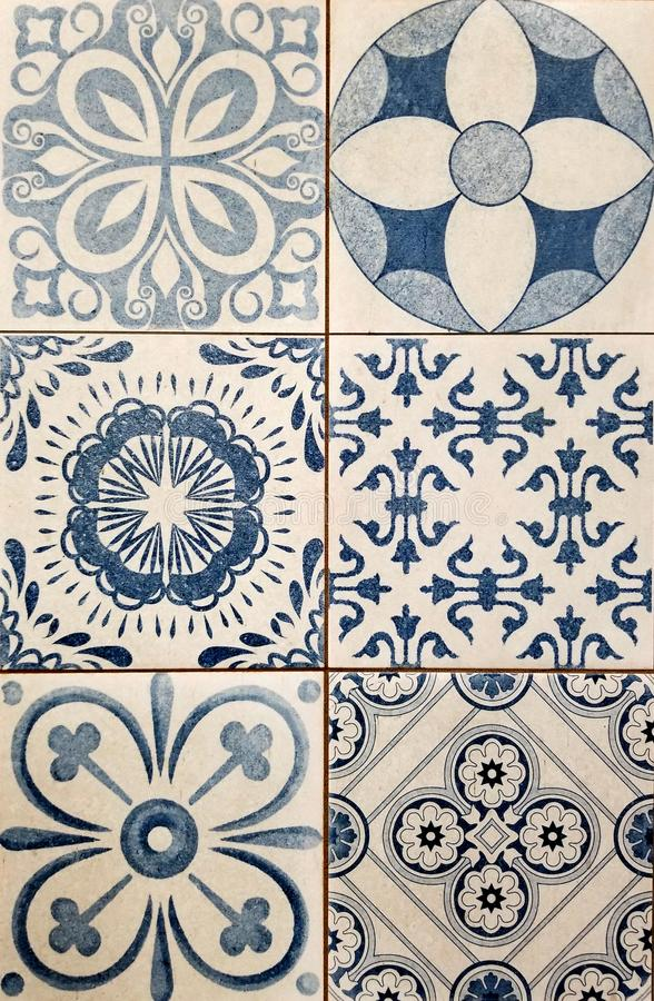 Texture - Array of Mediterranean style square tiles in white and blue. Texture - Array of six Mediterranean style square tiles in white and blue with abstract stock photography